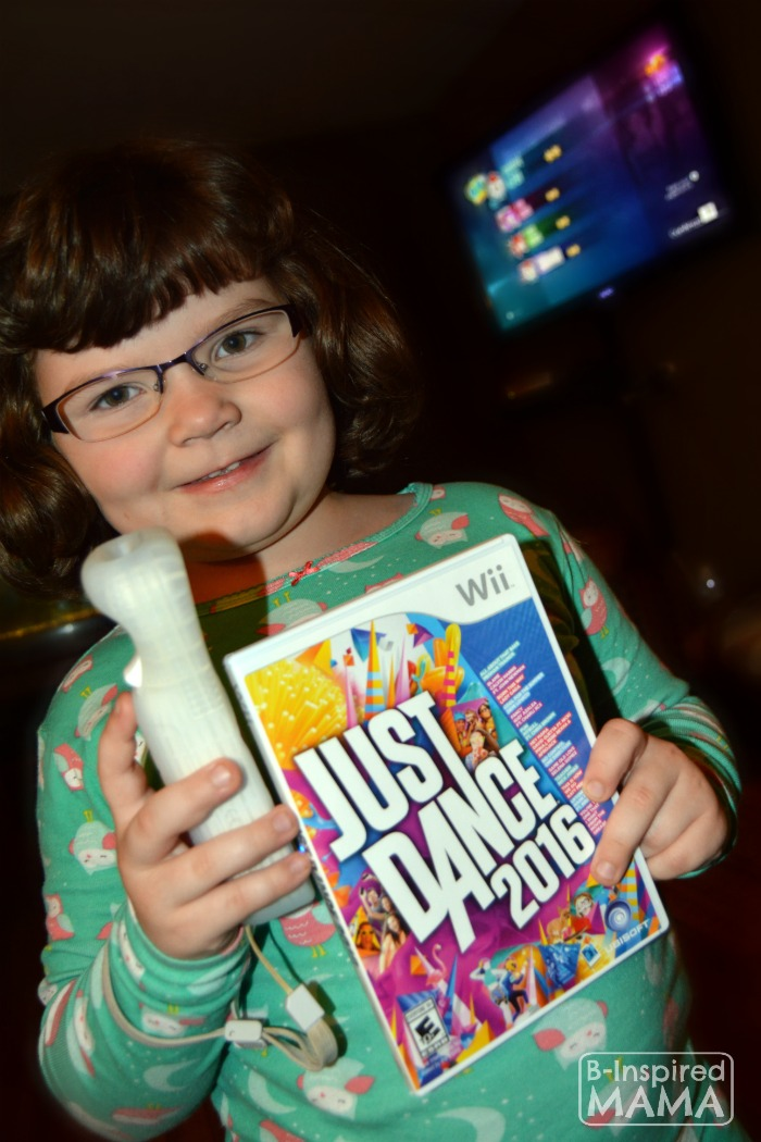 Fun Alternatives to Family Movie Night - Priscilla with her Just Dance Game - at B-Inspired Mama