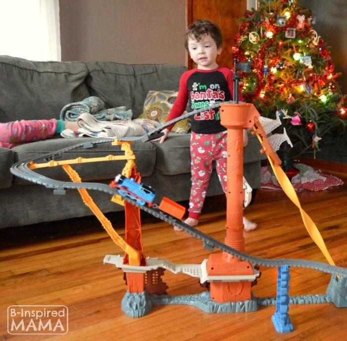 JC Watching Thomas go Up Up Up + A Printable Train Ticket Holiday Gift Tag at B-Inspired Mama