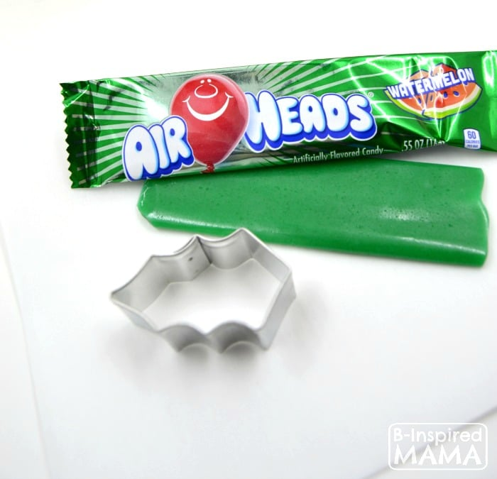 Make a Holly Cupcake Topper for Christmas Cupcakes - Using Watermelon Airheads - at B-Inspired Mama