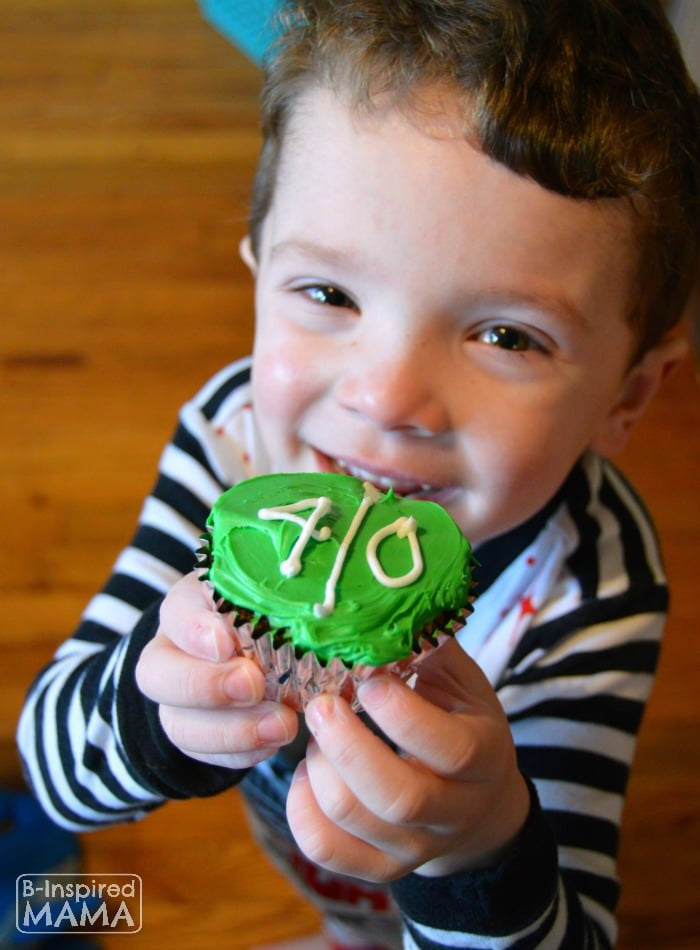 JC Showing Off his Football Game Day Brownie Cupcake - at B-Inspired Mama