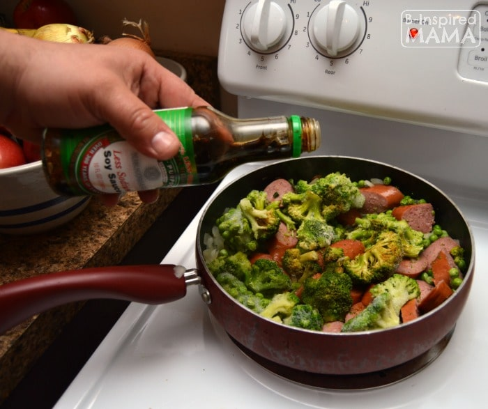 Anything Goes Sausage and Rice Skillet Meal - Adding Soy Sauce - at B-Inspired Mama