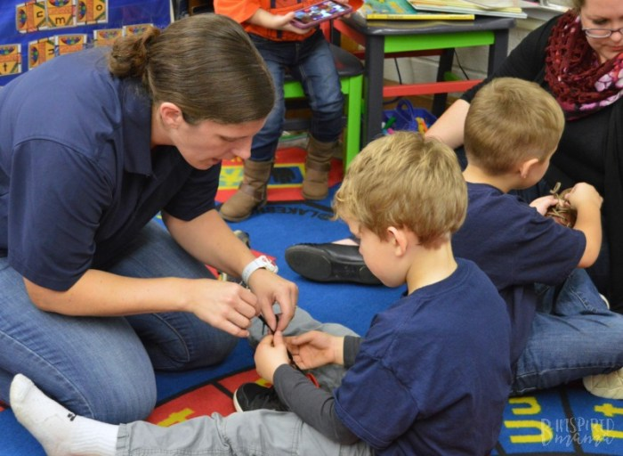 Kids learning shoe tying at their Lion Cub Scout Meeting - A new program Increasing the Cub Scouts Age to Kindergarten Boys