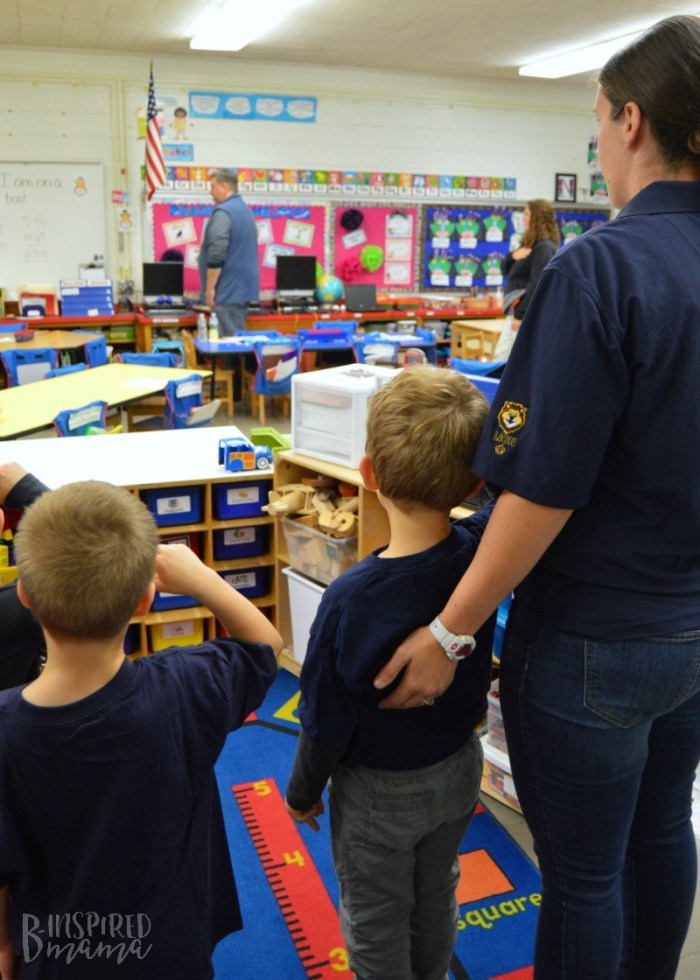 Kids saluting the Flag during their Lion Cub Scout Meeting - A new program Increasing the Cub Scouts Age to Kindergarten Boys