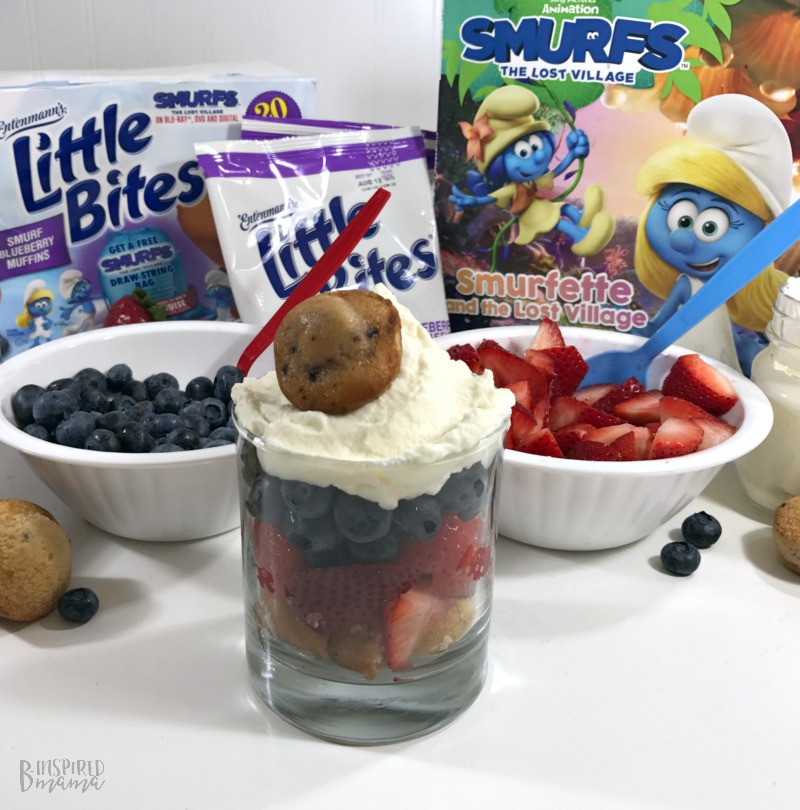 Adding our Homemade Whipped Cream to our Yummy Super Fun Smurf Blueberry Muffin Parfait Recipe