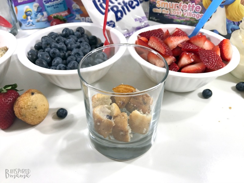 Starting with a layer of Little Bites Muffins for our Super Fun Smurf Blueberry Muffin Parfait Recipe