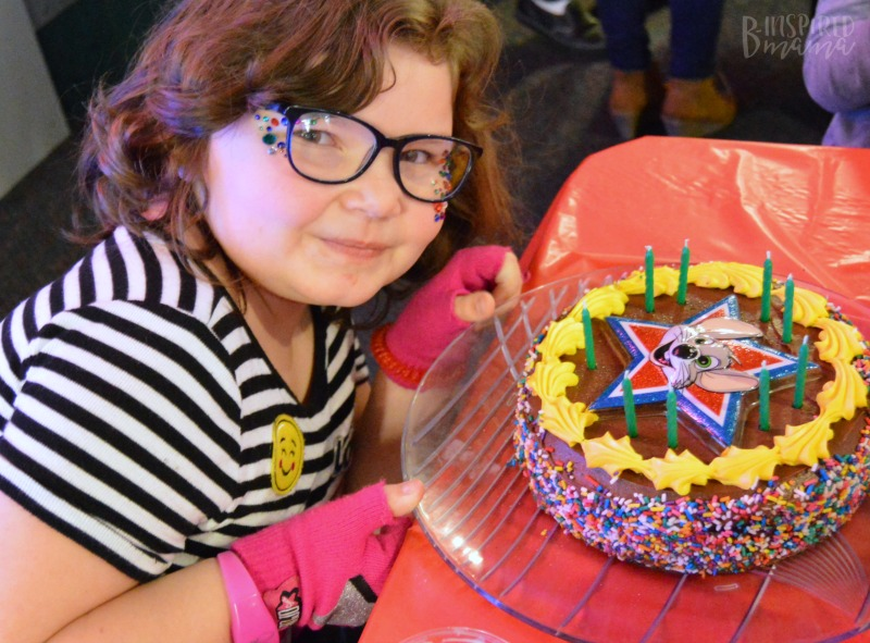 Priscilla with her cake at Chuck E. Cheese's + Birthday Traditions for Kids that are Meaningful but EASY! - at B-Inspired Mama