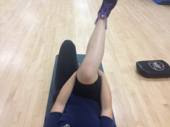 Medial rotation of femur during knee extension