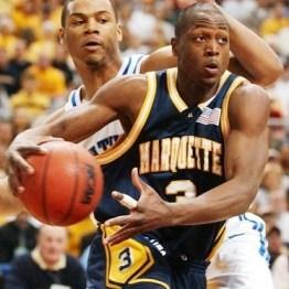 Dwyane Wade face à Chuck Hayes lors de Marquette-Kentucky (c) AP