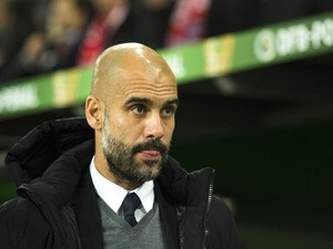Bayern Munich's Spanish head coach Pep Guardiola watch proceedings during the German Cup DFB Pokal second round football match between VfL Wolfsburg vs FCB Bayern Munich in Wolfsburg, on October 27, 2015.