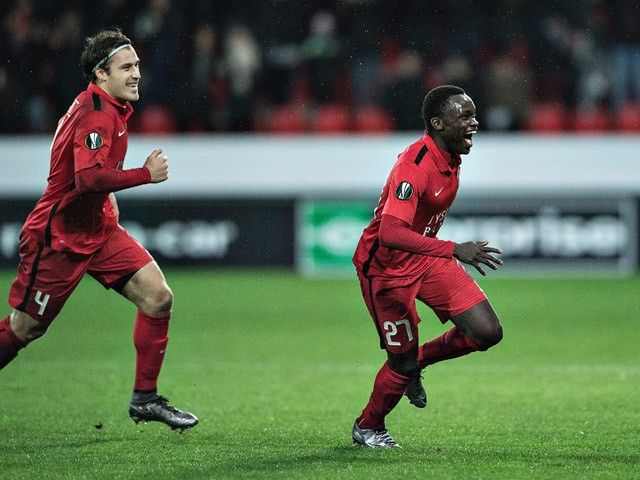 Pione Sisto of FC Midtjylland (R) reacts after scoring against Club Brugge during the UEFA Europa League group D football match between FC Midtjylland vs Club Brugge KV in Herning, Denmark on December 10, 2015