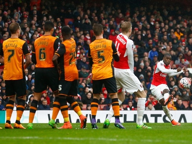 Joel Campbell of Arsenal takes a free kick saved by Eldin Jakupovic of Hull City in the FA Cup fifth round on February 20, 2016