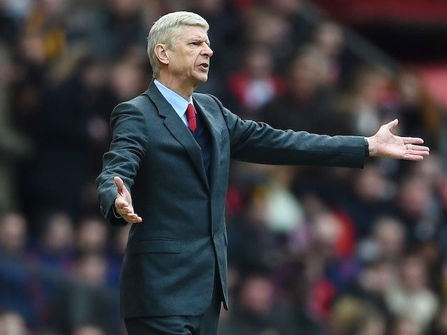 Arsene Wenger gestures during the Premier League game between Manchester United and Arsenal on February 28, 2016