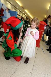 Youngsters queued to meet Santa when he opened the doors of his igloo at Northfield Shopping Centre. The busy shopping centre has been transformed into the North Pole, with animated winter wildlife and Eskimos helping Santa to  greet children Elf' Ruth Opie with Olivia Davies (4) from Selly Oak