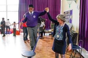 Mrs Connolly helps Amani cross the tightrope