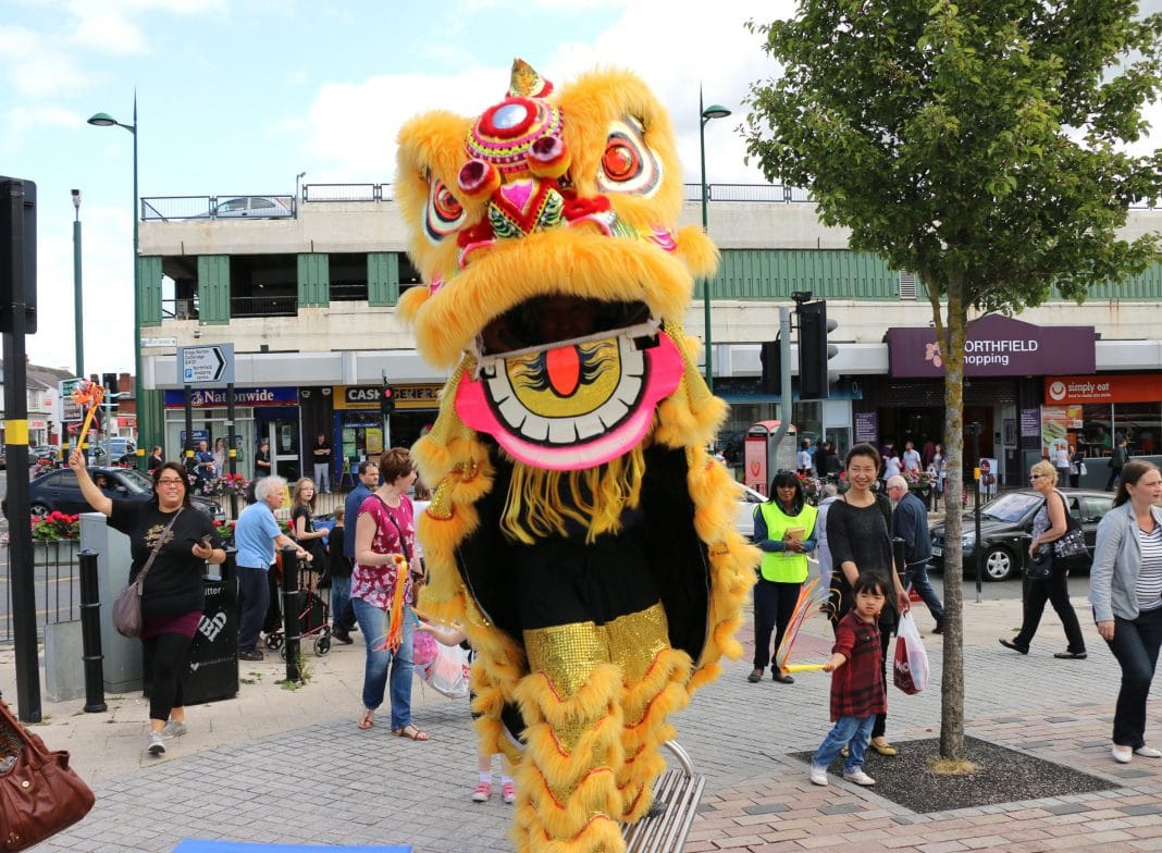 The Chinese Lion parade heads from Northfield Shopping Centre out into the town