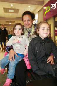 Bettina Reece, with her nieces, Taylor, 2 and Keeley 6, Humphrey, who enjoyed the fashion shows at Northfield Shopping Centre.