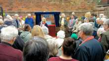Cllr Debbie Clancy (Con, Northfield) speaks to those gathered for the unveiling
