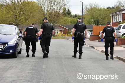 Officers comb the scene for evidence