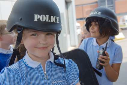 Children tried on riot gear