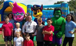(L-R) Vickie Wilkes, Poppy Troll, Jane Williams, Alun Roberts, Paw Patrol Chase, Hulk, Chloe Wilkes with Colmers Farm Primary pupils