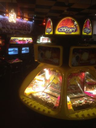 Coin pushers in the arcade, next to the open plan cafe bar