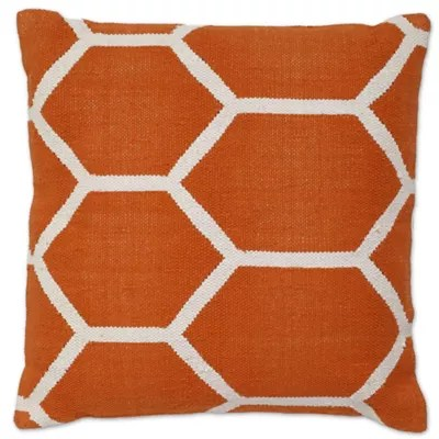 orange and blue throw pillows bed