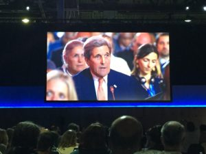 Delegates watch as Secretary Kerry voices U.S. support for the Paris Agreement. Photo by David Burns