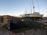 Camping outside the marina where Manfred's boat was moored. Not the best campsite ever but the security guard was very nice to us.