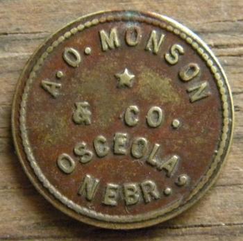 Image of circa 1900 token for Andrew Monson's store in Osceola, Nebraska. From tokencatalog.com.