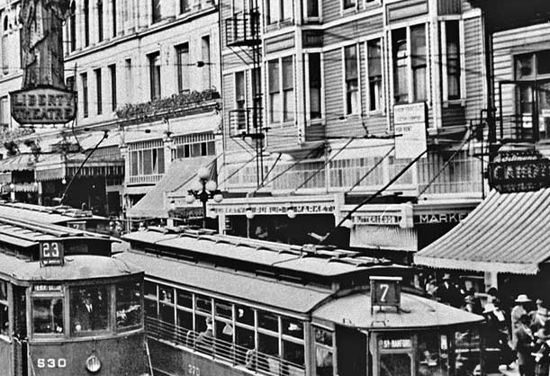 "Behind the streetcar jumble the awning says ""Liberty Public Market"". This is the first home of Piggly Wiggly in Seattle, demolished in 1924. (Paul Dorpat)"