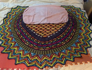 Sarah's shawl blocking and taking up most of a queen sized bed.