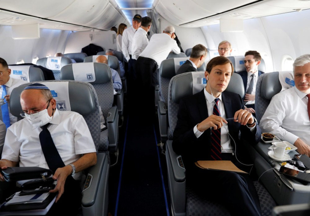 Meir Ben-Shabbat, Robert O'Brien and Jared Kushner are seated during a flight on Israeli flag carrier El Al airliner to Abu Dhabi, United Arab Emirates, August 31, 2020. (REUTERSNIR ELIAS).jpg