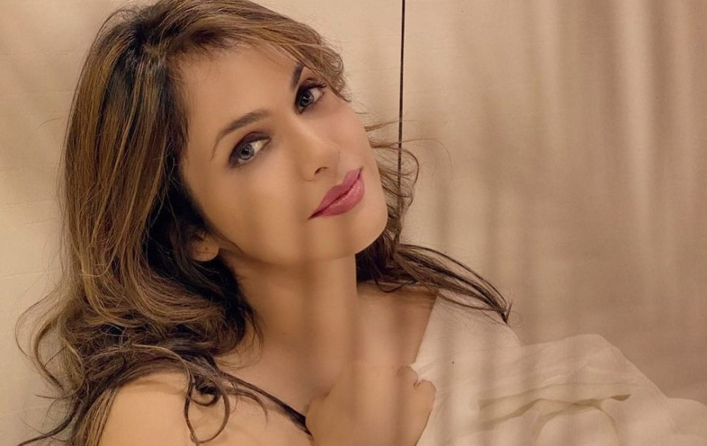 Isha Koppikar in Qayamat and Krishna Cottage
