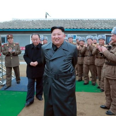 Trenchcoats And Rockets Kim Supervises N Korea Weapons Test