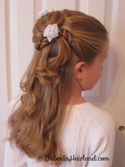 twisted flower girl hairstyle