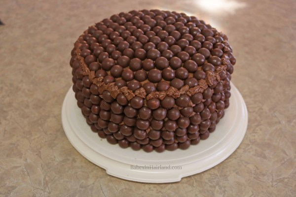 If you love chocolate and malt candy, this chocolate Whopper Cake will please your tastebuds! BabesInHairland.com | birthday cake | cake decorating |