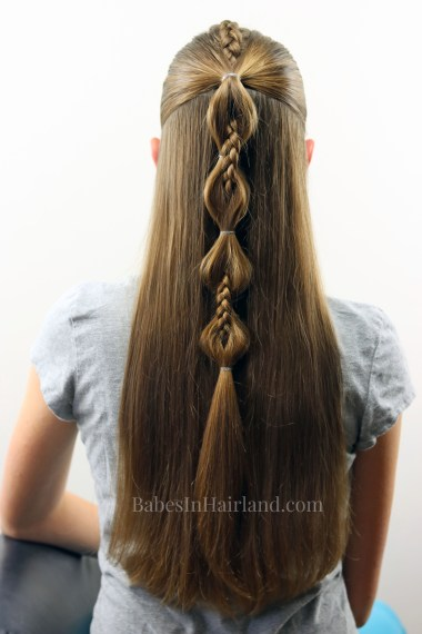 Combine a cool Dutch braid and bubble ponytail to create this edgy Peek-a-Boo French Braid hairstyle. BabesInHairland.com