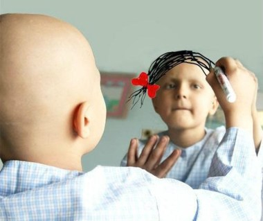 Little Cancer Patient Coloring on Hair in Mirror