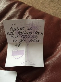 A piece of paper with a cocktail on it with the quote 'Failure is not falling down but refusing to get back up' written on it