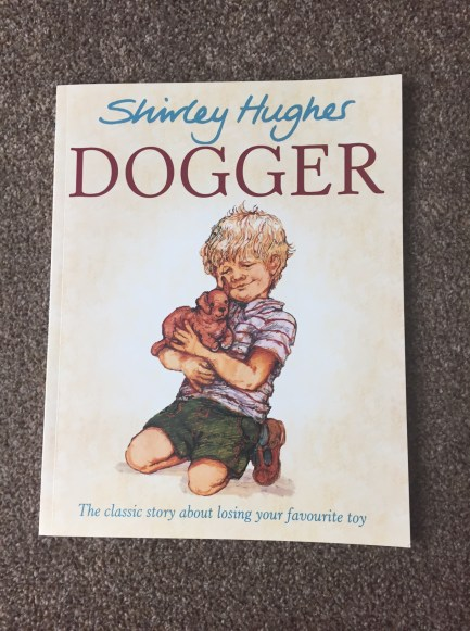 Dogger front cover - a boy holding his dog teddy