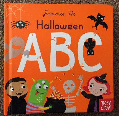 Halloween ABC book front cover - orange background with bats, ghosts, vampires, witch, skeletons, a cauldron etc...