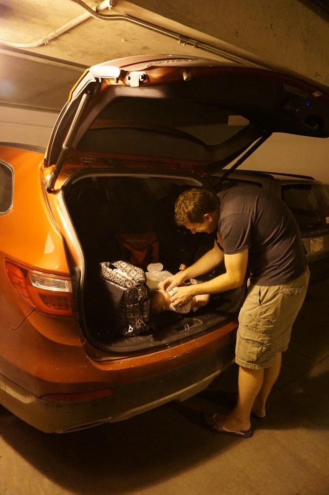Diaper change in a parking garage in Banff