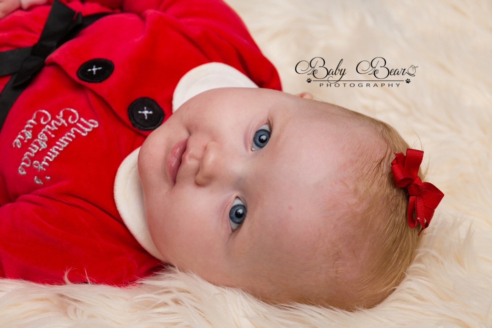 Baby wearing Christmas dress in coventry photoshoot