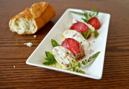 burrata appetizer with pluots and mint