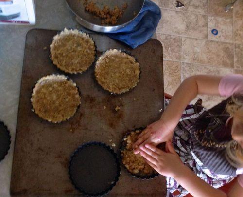 pressing crust into chestnut tart