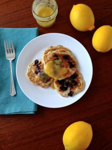 honey sweetened meyer lemon curd over blueberry pancakes