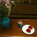 Tea and crumpets with strawberry jam