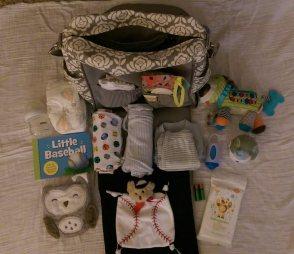 packing-the-diaper-bag-open-babycastanonboard.com