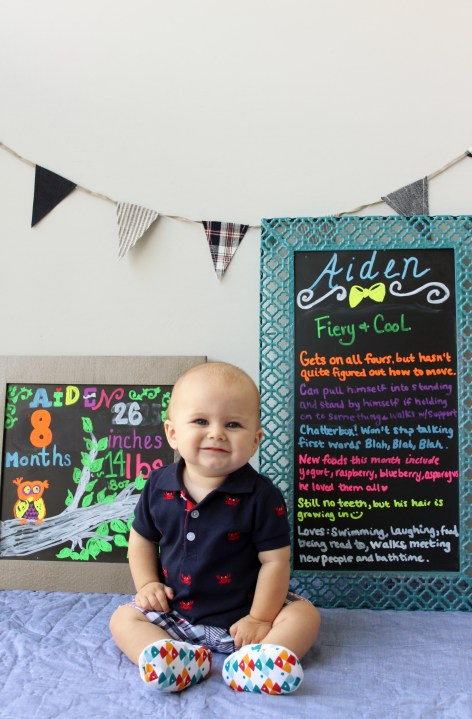 Aiden with chalkboards - Monthly Milestone Photos for Baby featured by popular DC mommy blogger, Baby Castan on Board