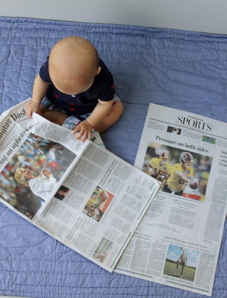 eight months baby update-looking-at-newspaper-dc-motherhood-blog